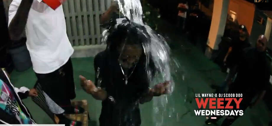 Rapper Lil Wayne takes the ALS challenge for his Weezy Wednesday YouTube feature.Video posted on YouTube by: Lil Wayne Photo: YouTube