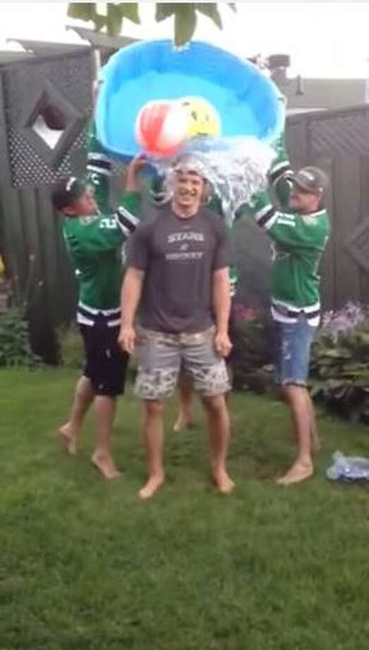 Antoine Roussel of the Dallas Stars gets help from three family members and a kiddie pool to complete the ice bucket challenge.Posted on YouTube by: Dallas Stars Photo: Molina, Maribel, YouTube