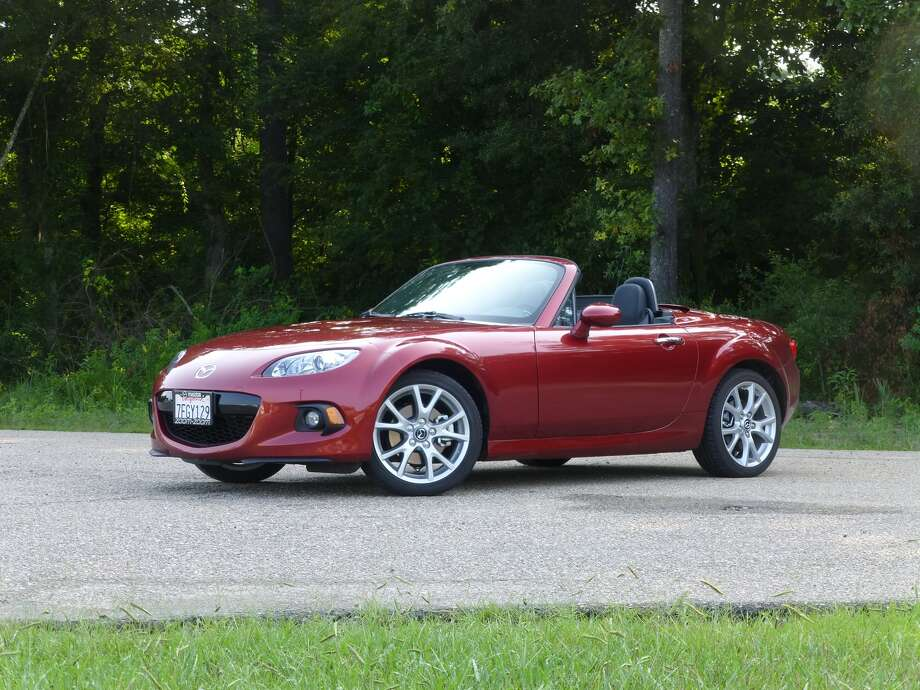 Mazda's Miata two-seat roadster may have aged a quarter of a century, yet it still acts like a kid, and it remains one heck of a fun car to drive.