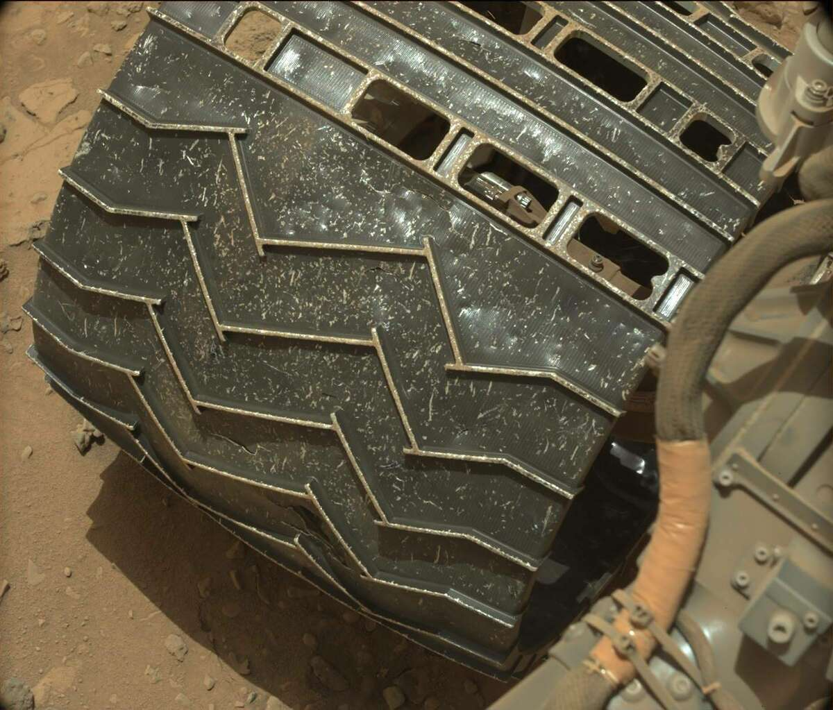 These before and after images from the Mars rover Curiosity show the wear and tear on the rover since it landed on Mars on Aug. 6, 2012. Each image is labeled with both the Sol day (Martian