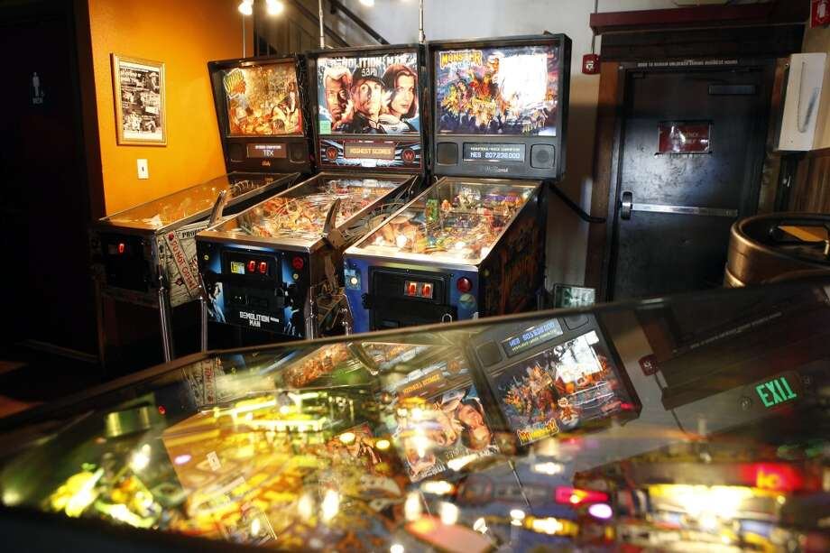 Pinball machines are seen at The Legionnaire bar in Oakland. Photo: Michael Short, The Chronicle
