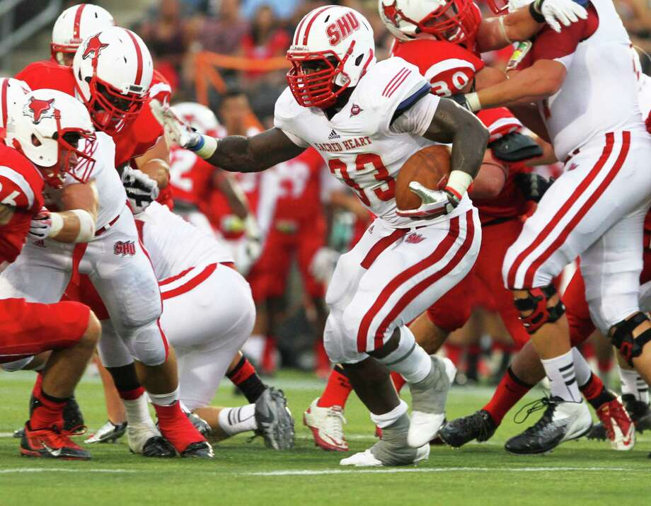 Sacred Heart's Keshaudas Spence looks for yardage in a recent game against Marist. Photo: Contributed Photo / Connecticut Post Contributed
