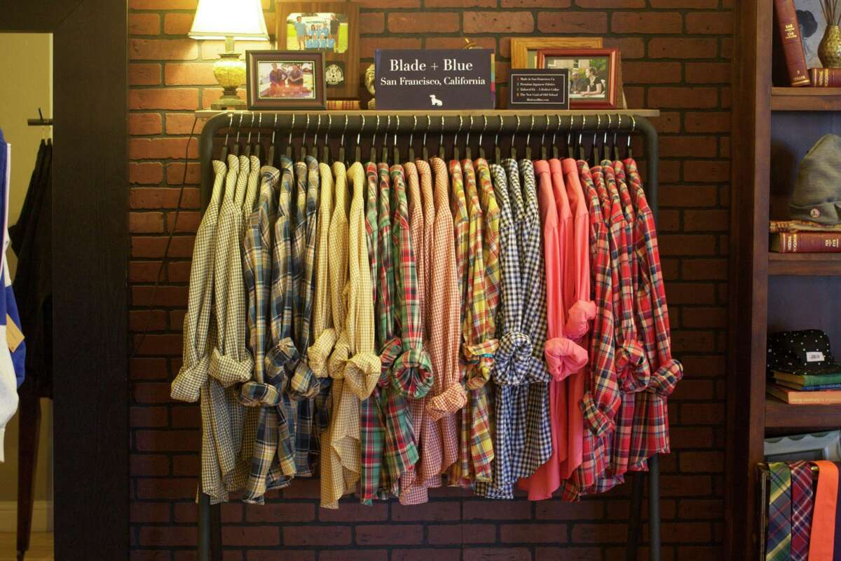 Men's woven shirts on a rack at Asmbly Hall on Fillmore Street.