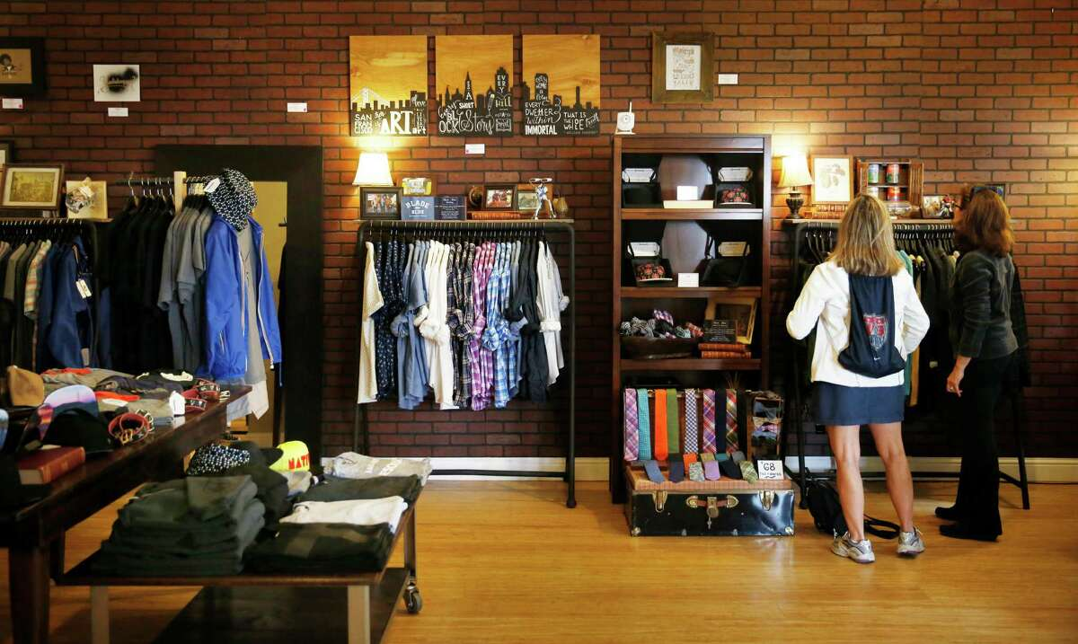 Shoppers looks through clothes while shopping at Asmbly Hall on Wednesday, August 13, 2014 in San Francisco, Calif.