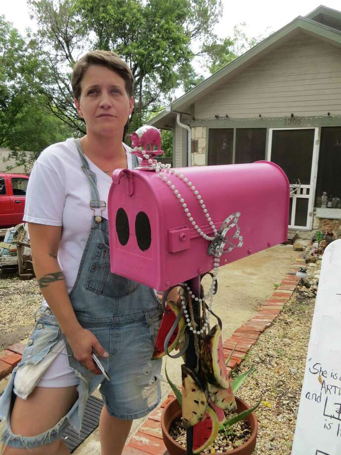 Renee Lofaso Massey said she's received donations and emotional support from other Kerrville citizens in what she casts as a fight to preserve her right to free expression. The city wants her to clean up the yard of her Allice Street home. Photo: Zeke MacCormack/San Antonio Expr