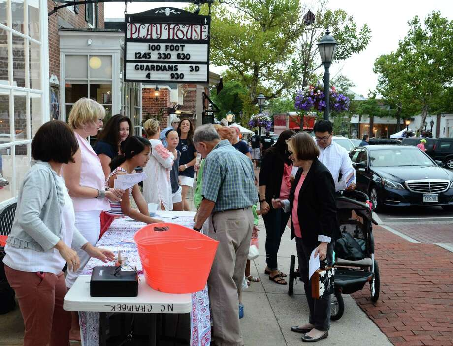 More than 500 people joined the fourth annual Taste of the Town Stroll in New Canaan, Conn., on Thursday, Aug. 21, 2014, and donated more than $6,000 worth of food to the New Canaan Food Pantry, according to the New Canaan Chamber of Commerce. Photo: Nelson Oliveira / New Canaan News