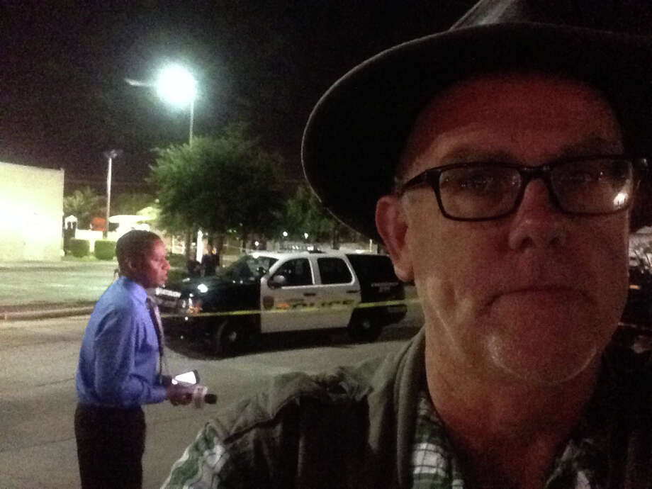 Self-portrait with crime scene. Photo: Mike Glenn, Houston Chronicle / Houston Chronicle
