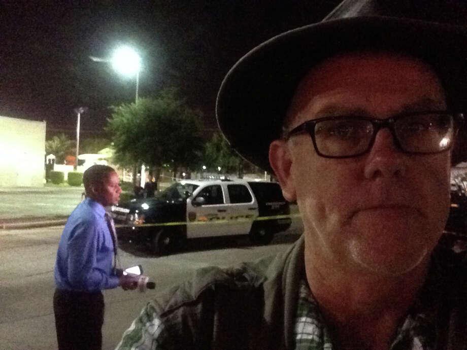 Self-portrait with crime scene. Photo: Mike Glenn, Houston Chronicle / Houston Chronicle