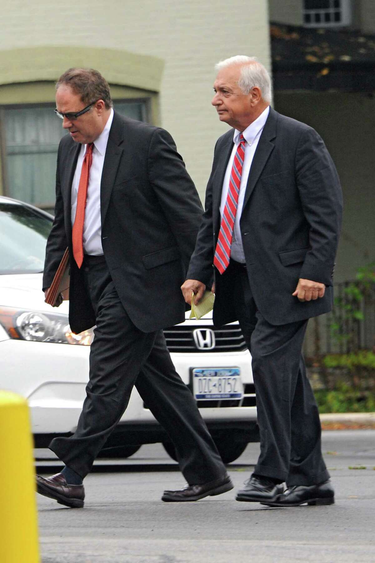 Bruce Tansk'si attorney William Dreyer, right, and Tanski's secretary Katina Fogerty's attorney John Sweeney arrive at the Saratoga County Courthouse on Friday, Aug. 22, 2014 in Ballston Spa, N.Y. Bruce Tanski, a prominent Halfmoon builder, was arrested by State Police on charges alleging he paid employees and business associates to make political contributions to the campaign account of Melinda Wormuth, a former Halfmoon town supervisor. Katina Fogerty was charged with a single count of concealing the true origin of a campaign donation. (Lori Van Buren / Times Union)