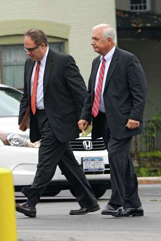 Bruce Tansk'si attorney William Dreyer, right, and Tanski's secretary Katina Fogerty's attorney John Sweeney arrive at the Saratoga County Courthouse on Friday, Aug. 22, 2014 in Ballston Spa, N.Y. Bruce Tanski, a prominent Halfmoon builder, was arrested by State Police on charges alleging he paid employees and business associates to make political contributions to the campaign account of Melinda Wormuth, a former Halfmoon town supervisor. Katina Fogerty was charged with a single count of concealing the true origin of a campaign donation. (Lori Van Buren / Times Union) Photo: Lori Van Buren / 00028289A
