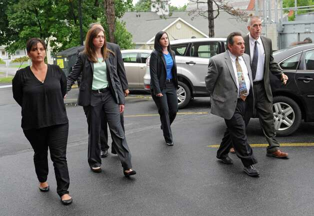 Bruce Tanski's secretary Katina Fogarty, left, and Nicholas DiNova Jr., second from right, an employee of Troy Sand & Gravel who lives in a home Tanski built, are brought to the Saratoga County Courthouse in custody by FBI agents and state attorney generals investigators  on Friday, Aug. 22, 2014 in Ballston Spa, N.Y. The two were being charged with a single count of concealing the true origin of a campaign donation. Bruce Tanski, a prominent Halfmoon builder, was arrested by State Police on charges alleging he paid employees and business associates to make political contributions to the campaign account of Melinda Wormuth, a former Halfmoon town supervisor. (Lori Van Buren / Times Union) Photo: Lori Van Buren / 00028289A