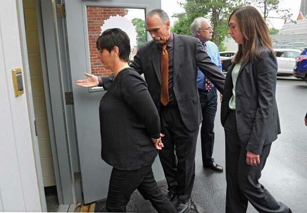 Bruce Tanski's secretary Katina Fogarty, left, is brought to the Saratoga County Courthouse in custody by FBI agents and state attorney generals investigators for her arraignment on a charged with a single count of concealing the true origin of a campaign donation on Friday, Aug. 22, 2014 in Ballston Spa, N.Y. Bruce Tanski, a prominent Halfmoon builder, was arrested by State Police on charges alleging he paid employees and business associates to make political contributions to the campaign account of Melinda Wormuth, a former Halfmoon town supervisor. (Lori Van Buren / Times Union) Photo: Lori Van Buren / 00028289A