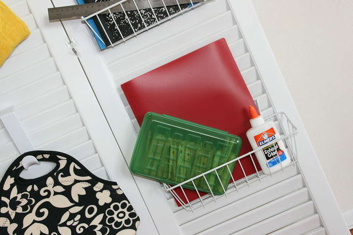 Small wire bins hook onto shutters to contain school supplies. The project by C.R.A.F.T. blogger Jamie Dorobek of Austin is featured on Hometalk.