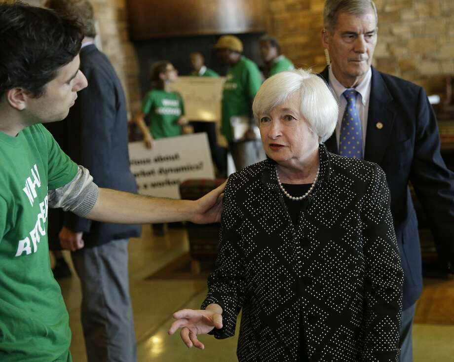 Demonstrators greet Federal Reserve Chairwoman Janet Yellen at the economic conference in Jackson Hole, Wyo. Photo: John Locher, Associated Press