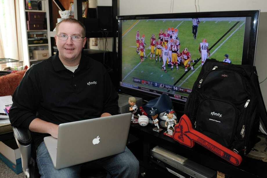Bryan Mapes poses while watching sports at his home in Brookfield, Conn. Friday, Aug. 22, 2014.  Mapes won the 2014 Xfinity Ultimate Sports Social Media Job by out-tweeting the competition.  He won out over thousands of applicants for the job of keeping sports fans updated on social media. Photo: Tyler Sizemore / The News-Times