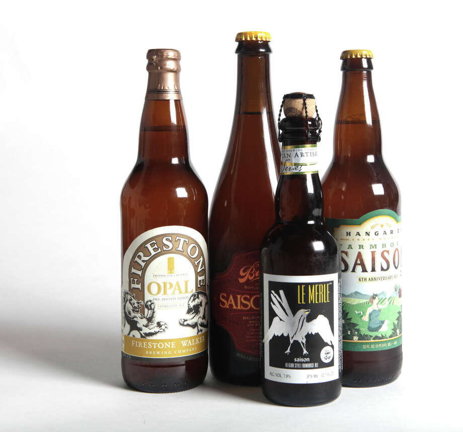 From left to right, bottles of Firestone Walker Opal Proprietor's Reserve ($7.99/22 oz.; 7.5%), The Bruery Saison Rue ($12.99/22 oz.; 9.5%), North Coast Le Merle Saison ($4.99/12.7 oz.; 7.9 %), and Hangar 24 6th Anniversary Farmhouse Saison ($9.99/22 oz.; 6.1%) are photographed in San Francisco, Calif., on Thursday, August 14, 2014.  (Dylan Entelis/The Chronicle) Photo: Dylan Entelis / The Chronicle / ONLINE_YES