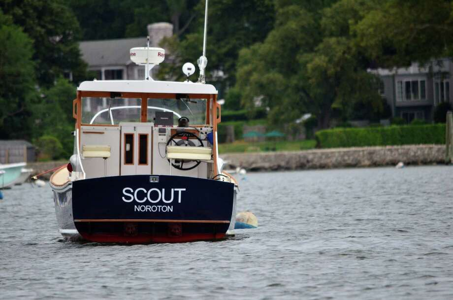 Darien Boat Club and Noroton Yacht Club members make their boats unique with a variety of names, like Scout. Photo: Megan Spicer / Darien News