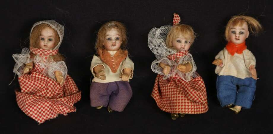 Four German doll house dolls. ($150-$250) Photo: Lewis And Maese