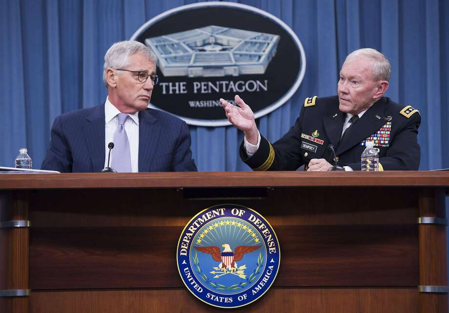 "US Secretary of Defense Chuck Hagel (L) and Chairman of the Joint Chiefs of Staff General Martin Dempsey hold a press briefing at the Pentagon in Washington, DC, August 21, 2014. Hagel warned that the Islamic State is more than a traditional ""terrorist group"" and better armed, trained and funded than any recent threat. ""They marry ideology and a sophistication of strategic and tactical military prowess. They are tremendously well funded. This is beyond anything we have seen,"" Hagel told reporters.   AFP PHOTO / Saul LOEBSAUL LOEB/AFP/Getty Images Photo: Saul Loeb, AFP/Getty Images"