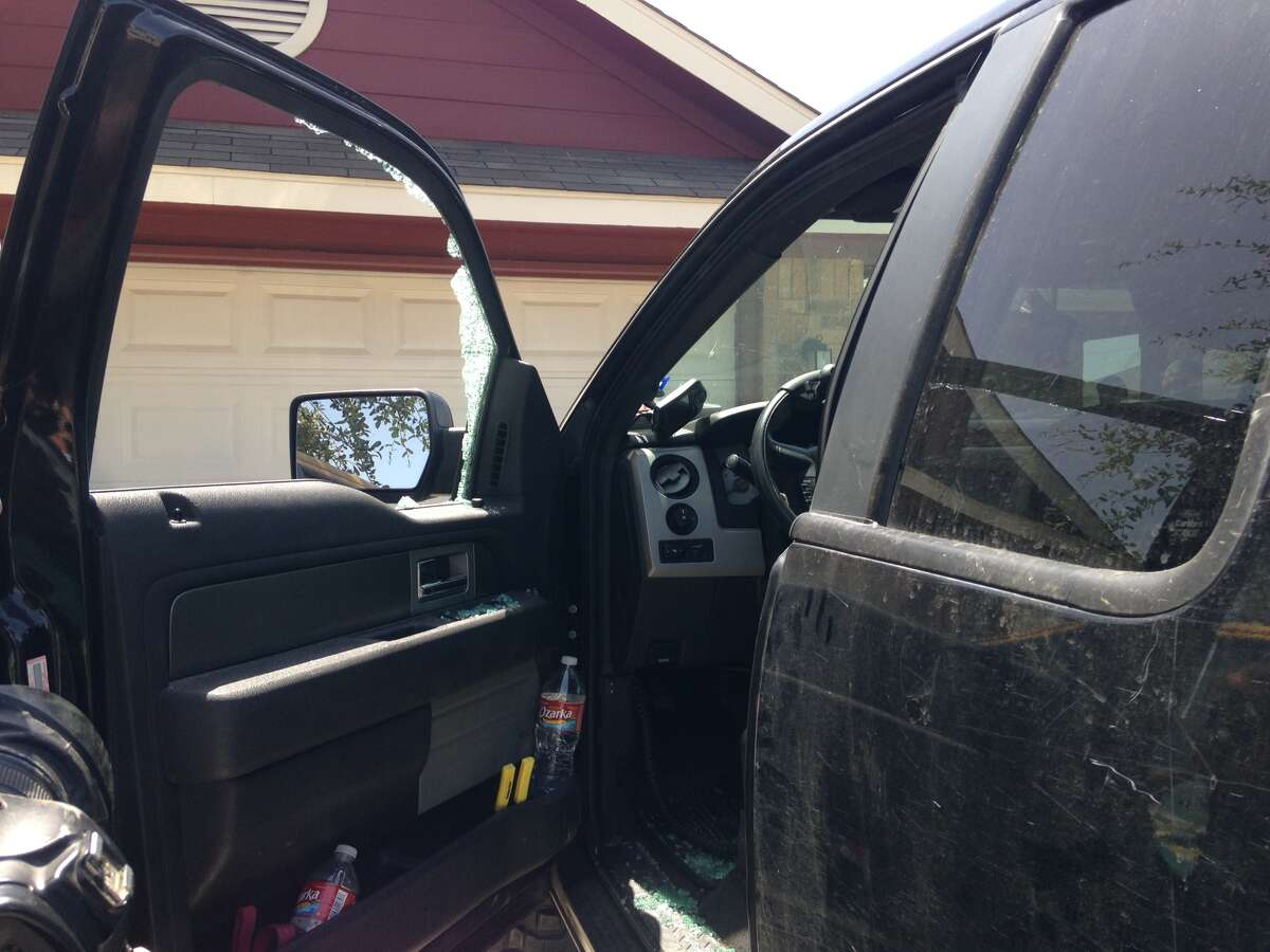 Someone smashed the window of retired Staff Sgt. Ben Eberle's pickup truck on Friday, August. 22, 2014, on the Northeast Side and swiped the iPod Touch that controls his prosthetic hand.