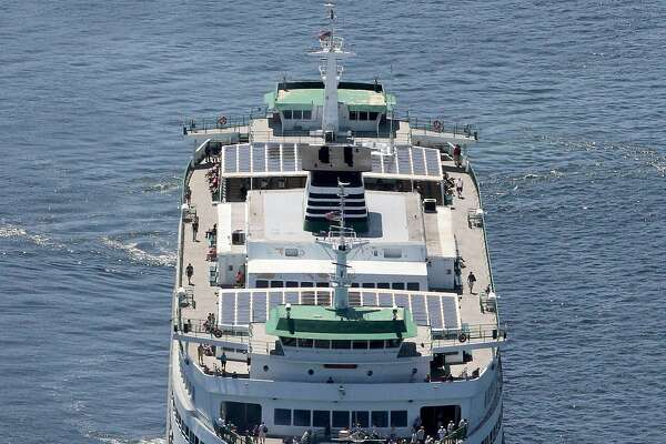 In this July 29, 2014 photo, the ferry Tacoma is towed back to Bainbridge Island, Wash., after an electrical failure left it dead in the water. Officials have warned for years about the chronic shortchanging of the ferries, and they're wondering now whether a recent series of mishaps is just coincidence, or a more troubling sign of how deeply the state has cut into a transportation system that is a major economic driver and a lifeline for many communities. (AP Photo/The Seattle Times, Alan Berner) OUTS: SEATTLE OUT, USA TODAY OUT, MAGAZINES OUT, TELEVISION OUT, SALES OUT. MANDATORY CREDIT TO: ALAN BERNER  / THE SEATTLE TIMES.