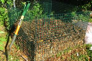 This compost container is made with a 3-cubic-foot wire bin with an open bottom, but there are many variations.