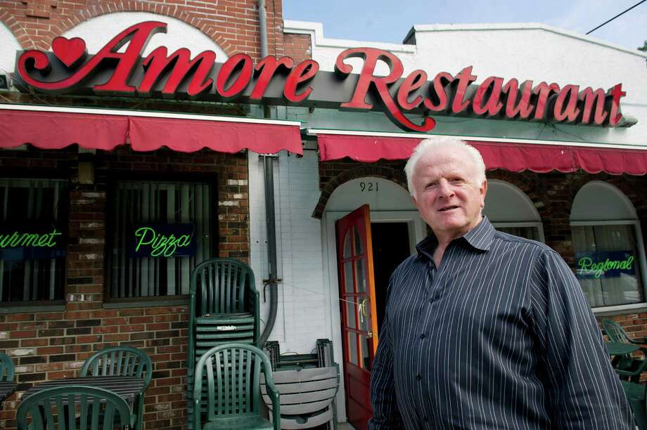Retiring Amore owner Al Carozza poses for a photo at the Stamford restaurant on Friday, August 22, 2014. Photo: Lindsay Perry / Stamford Advocate