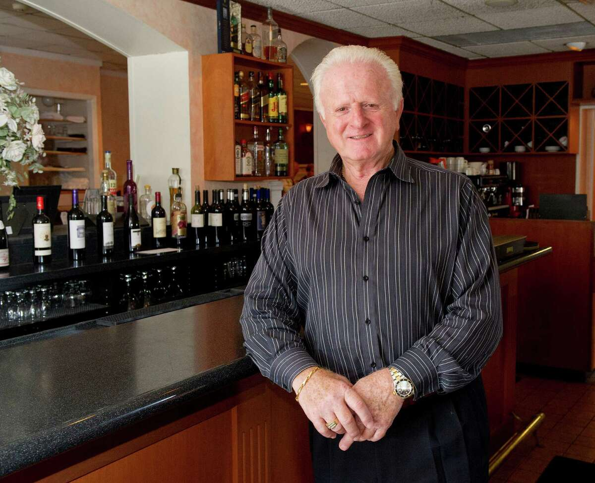 Retiring Amore owner Al Carozza poses for a photo at the Stamford restaurant on Friday, August 22, 2014.