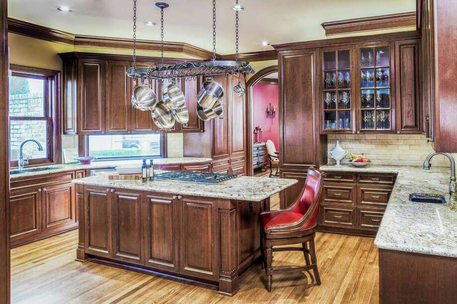 Shown is a kitchen renovation by Keechi Creek Builders.