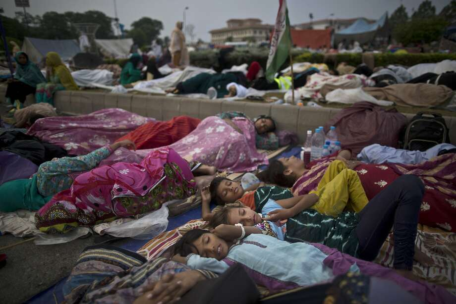 Protesters sleeping in front of Pakistan's parliament want Prime Minister Nawaz Sharif ousted. Photo: Muhammed Muheisen, Associated Press