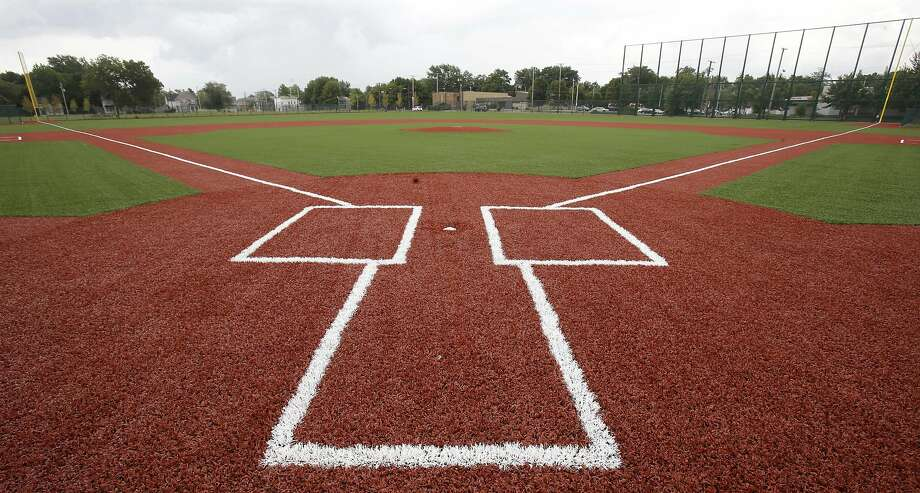 The restored field, left, is part of a $6.3 million rebuilding project. Photo: Tony Dejak, Associated Press