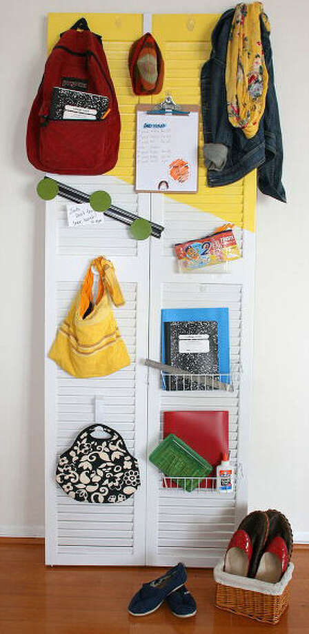 Backpacks, bags, message boards and school notebooks have space on a bi-fold door created by blogger Jamie Dorobek. See this project and other organizing ideas on Hometalk.