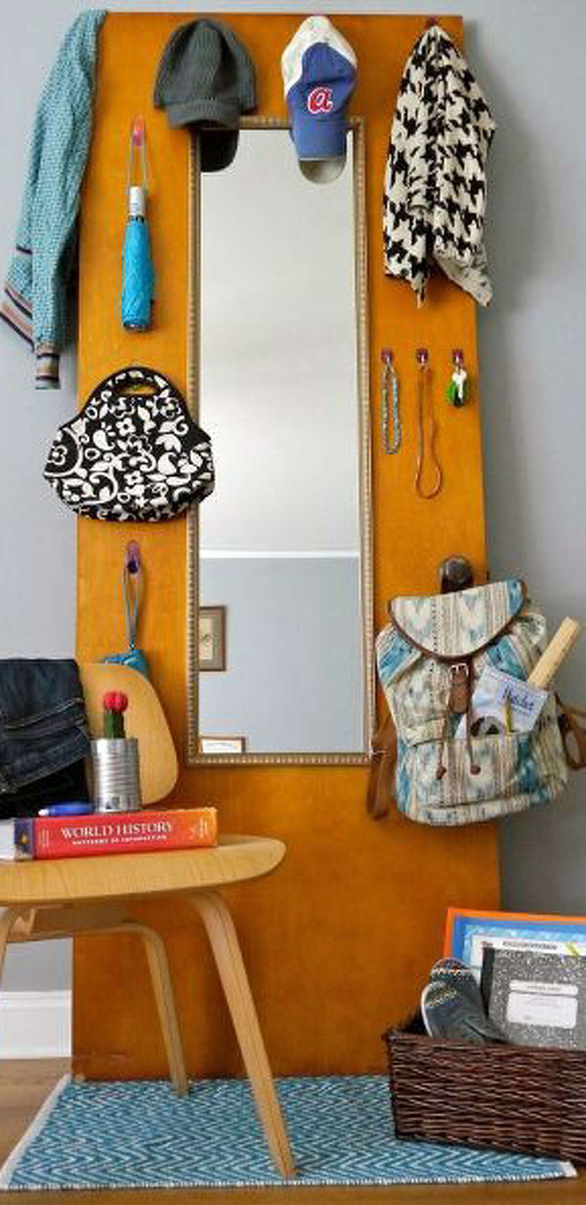 Jamie Dorobek turned a door into an organization station with a mirror and hooks. See it on Hometalk.