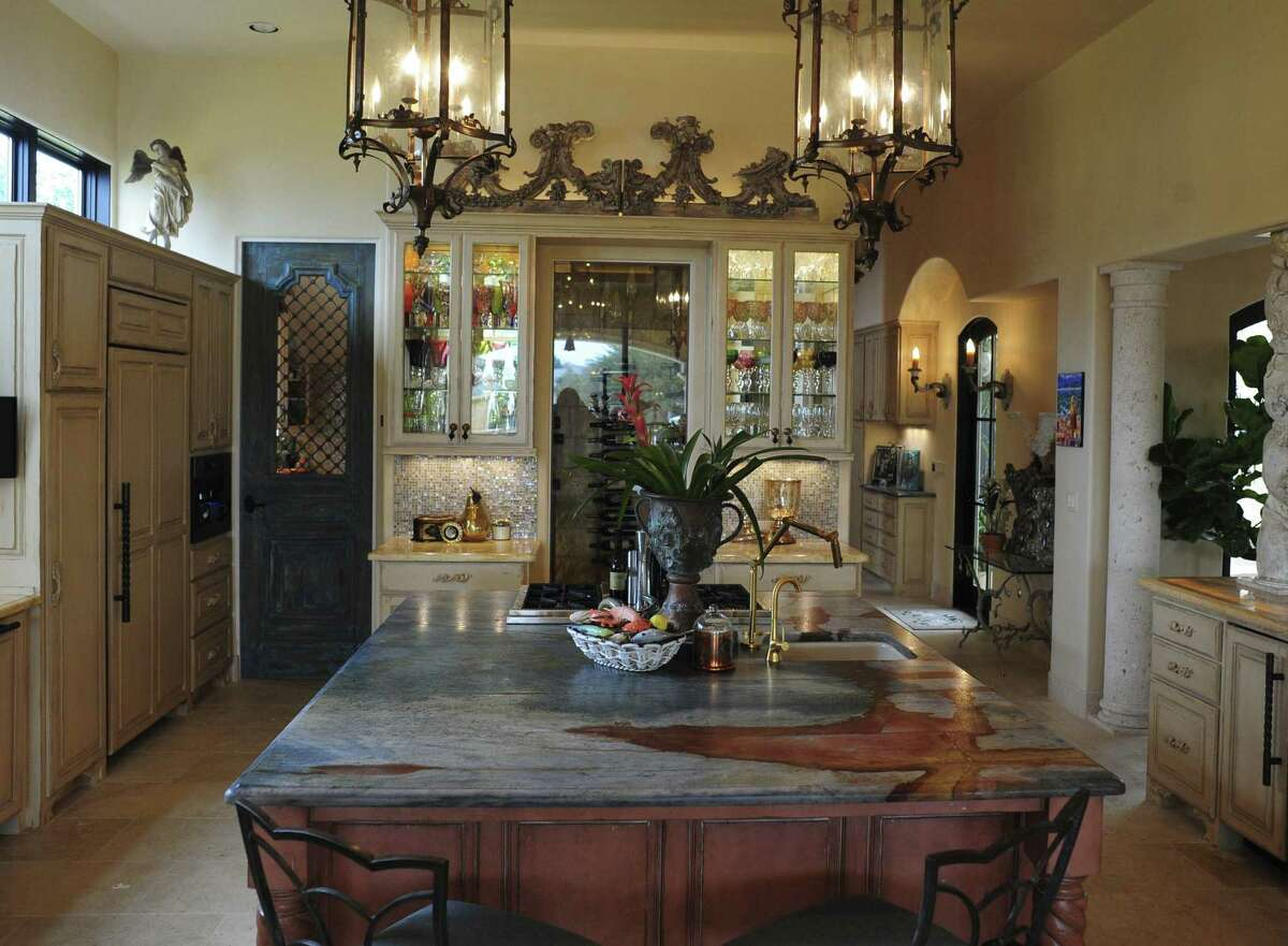 The kitchen in the Stanley family home includes classical architectural elements.