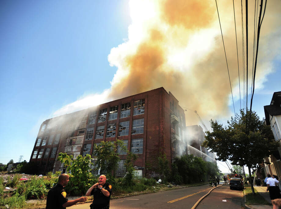 Bridgeport firefighters battle a blaze at the abandoned Rem-Grit factory buildings at Barnum Avenue and Helen Street in Bridgeport, Conn. on Tuesday, August 19, 2014. Photo: Brian A. Pounds / Connecticut Post