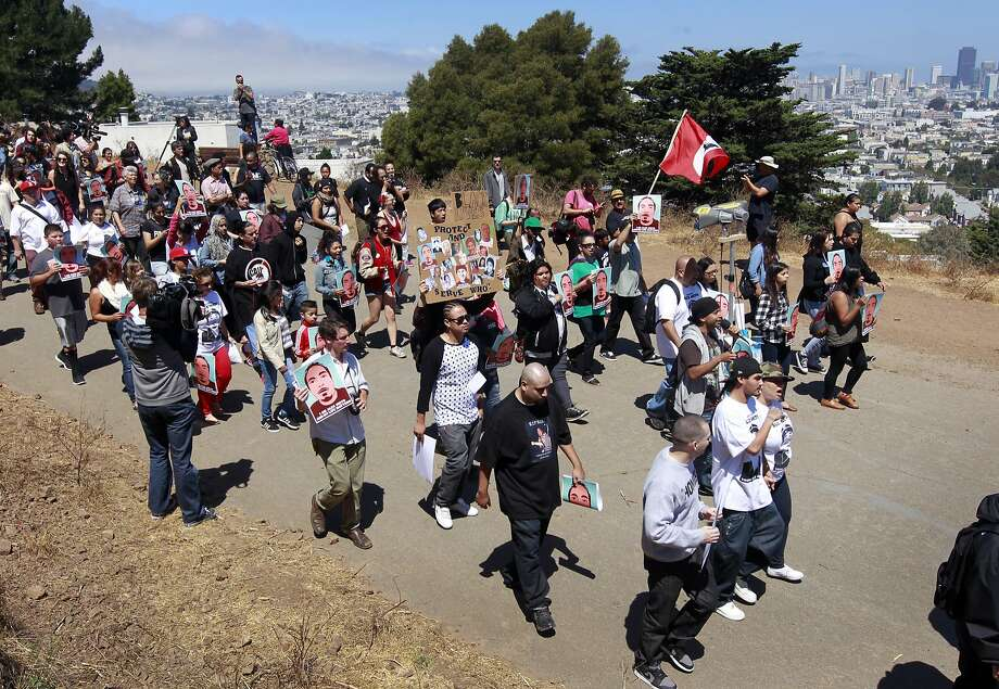 Above: Supporters demanding justice for Alex Nieto march from Bernal Heights Park to the U.S. District Court, where Nieto's family filed a civil rights lawsuit. Photo: Paul Chinn, The Chronicle