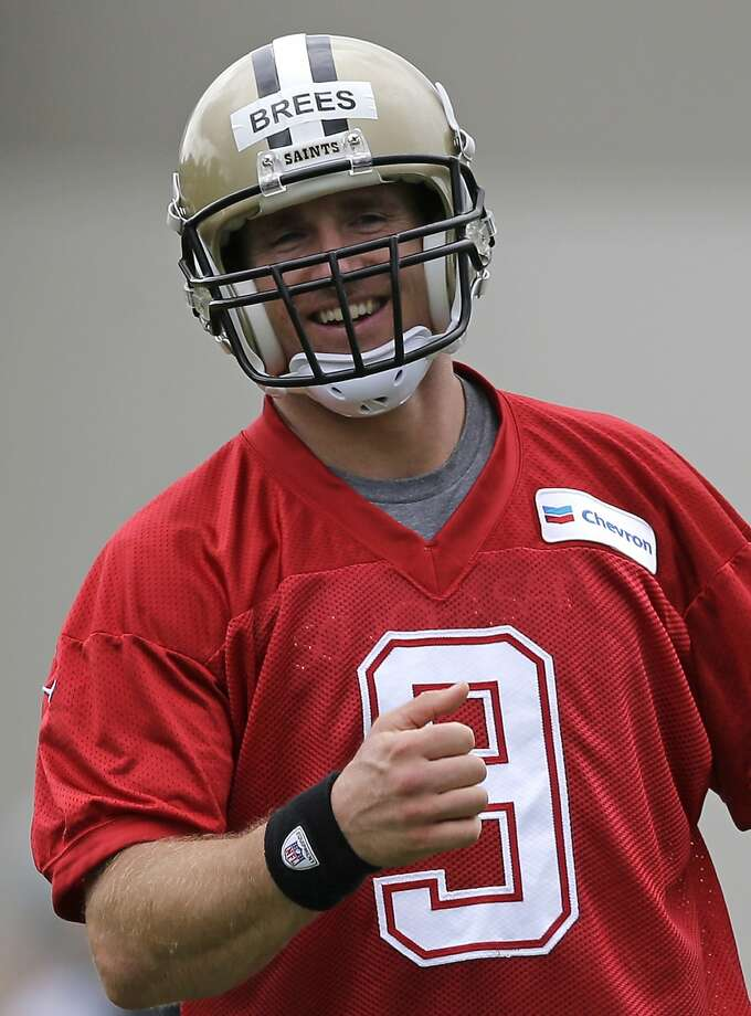 Drew Brees is hampered by a strained left oblique muscle, but he'll start Saturday's exhibition game. Photo: Gerald Herbert, Associated Press