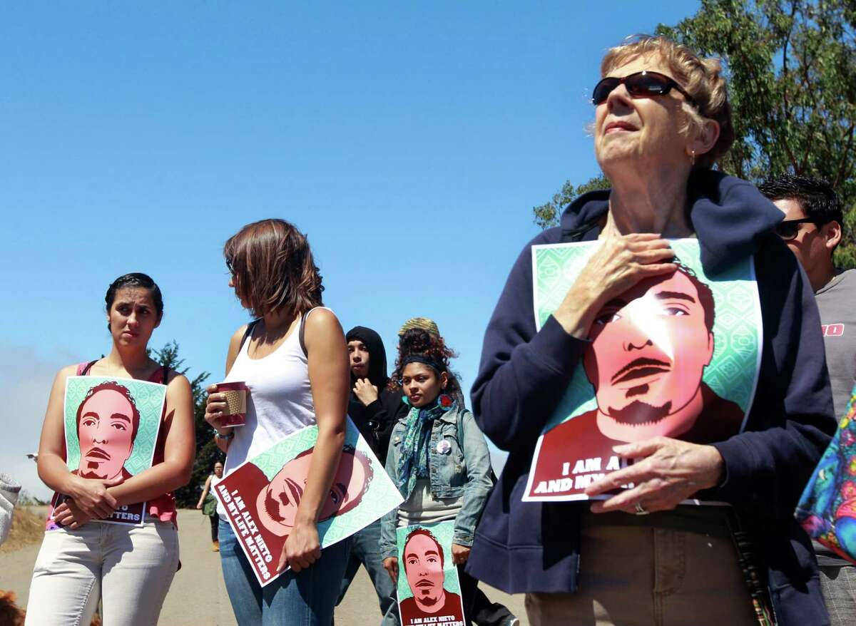 Carol Jauch (right) joins other protesters at a rally and march from Bernal Heights Park to the Federal Building demanding justice for Alex Nieto in San Francisco, Calif. on Friday, Aug. 22, 2014. The demonstrators are angry that the police shot and killed Nieto, who was holding a taser, in the park early on March 21. San Francisco police released the names of four officers involved in the shooting on Friday, Jan. 2, 2015, following a court order.