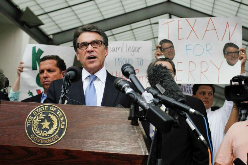 Gov. Rick Perry, governor of Texashis supporters and the media after being booked on charges of publ