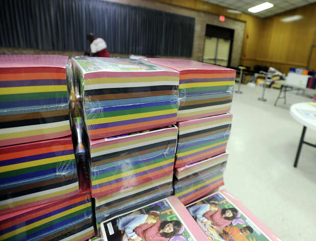 Reams of construction paper are stacked on a table inside the BISD board room before the doors opened to teachers Friday morning. The Adopt a BISD Teacher program gave away school supplies to teachers on Friday morning. Sarah Sanders, a former West Brook student, said the group raised $25,000 to spend on teaching supplies, and that computers at stores where they shopped kept crashing due to the bulk orders. Teachers were allotted 35 points to spend on supplies, which were organized and given point values in relation to their price.  Photo taken Friday 8/22/14 Jake Daniels/@JakeD_in_SETX Photo: Jake Daniels / ©2014 The Beaumont Enterprise/Jake Daniels