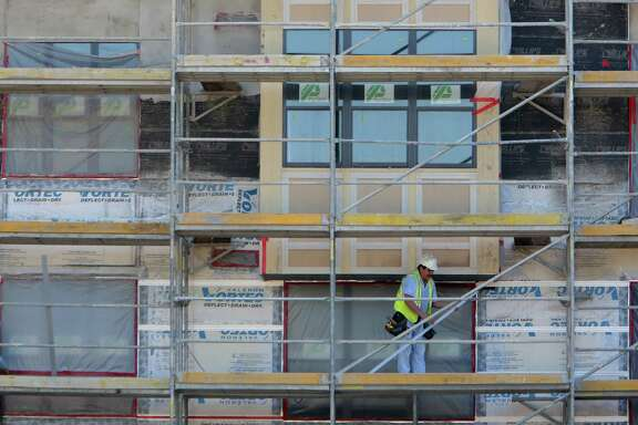 The construction crew works at The Susanne, a luxury apartment complex, construction site on Wednesday, Aug. 13, 2014, in Houston.  ( Mayra Beltran / Houston Chronicle )