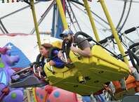 Logan Kinney, left, and Rob Baehm of Glens Falls take a ride on the Kite Flyer at the Washington County Fair on Friday, Aug. 22, 2014, in Greenwich, N.Y. (Michael P. Farrell/Times Union)