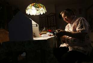 Artist Frank Wong works on making a diorama of a Chinatown gift shop for his grandson in his apartment in San Francisco, Calif. on Tuesday, August 19, 2014.