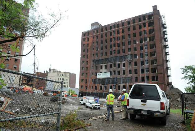 Demolition crews work on getting the Wellington Hotel Annex on Howard Street ready to be imploded Friday afternoon, Aug. 22, 2014, in Albany, N.Y. The building is scheduled to come down Saturday morning at around 9:30. (Lori Van Buren / Times Union) Photo: Lori Van Buren / 00028306A