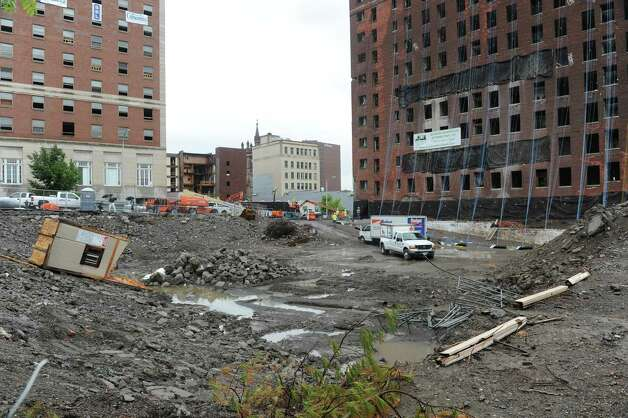 Demolition crews work on getting the Wellington Hotel Annex on Howard Street ready to be imploded Friday afternoon, Aug. 22, 2014, in Albany, N.Y. The building is scheduled to come down Saturday morning at around 9:30. (Lori Van Buren / Times Union)) Photo: Lori Van Buren / 00028306A
