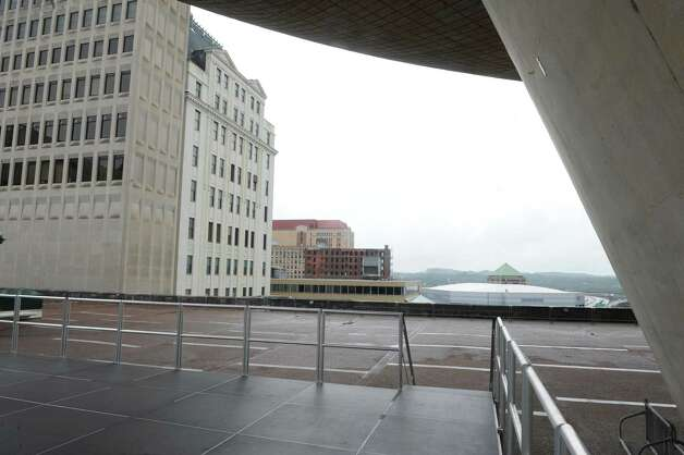 The Wellington Hotel Annex on Howard Street is seen from a stage under the Egg at the Empire State Plaza on Friday, Aug. 22, 2014 in Albany, N.Y. The building is set to be imploded Saturday morning at around 9:30 a.m. Spectators might be able to view the implosion from this stage which is used for summer lunchtime concerts. (Lori Van Buren / Times Union) Photo: Lori Van Buren / 00028306A