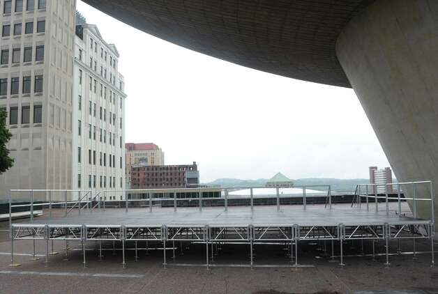 The Wellington Hotel Annex on Howard Street is seen from under the Egg at the Empire State Plaza on Friday, Aug. 22, 2014 in Albany, N.Y. The building is set to be imploded Saturday morning at around 9:30 a.m. Spectators might be able to view the implosion from this stage which is used for summer lunchtime concerts. (Lori Van Buren / Times Union) Photo: Lori Van Buren / 00028306A