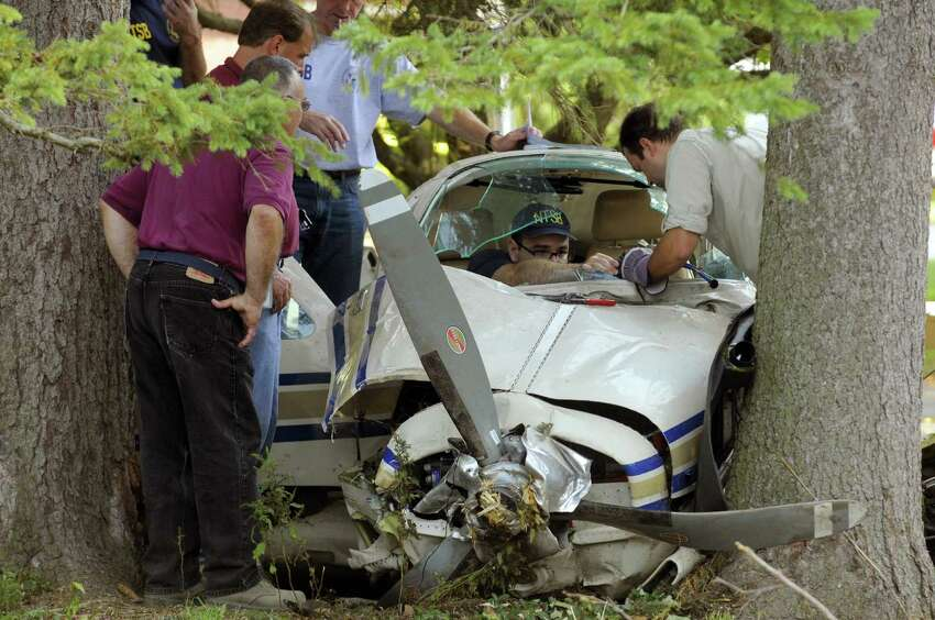 Investigators work at the site of a plane crash on Van Vranken Road in Thursday Aug. 16, in Clifton Park, N.Y. (Michael P. Farrell/Times Union archive)