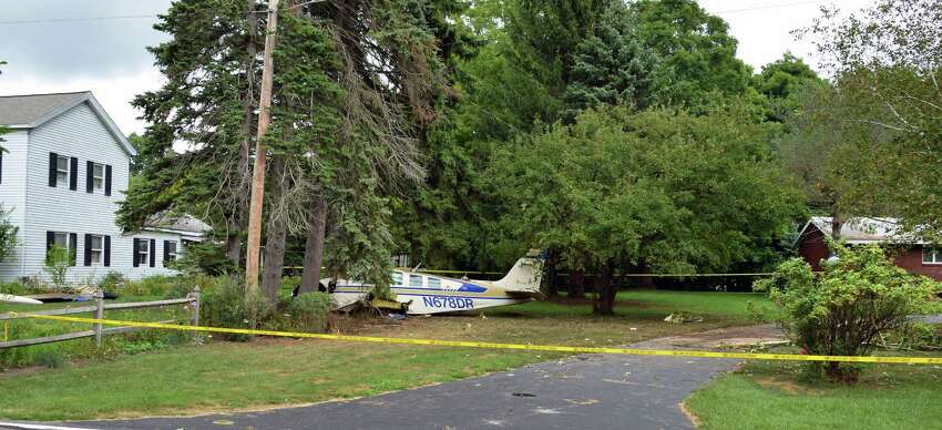 A small single engine private plane came to rest between 55, left, and 53 Van Vranken Road after it crashed Wednesday, Aug. 15, 2012, in Clifton Park, N.Y. (John Carl D'Annibale / Times Union archive)