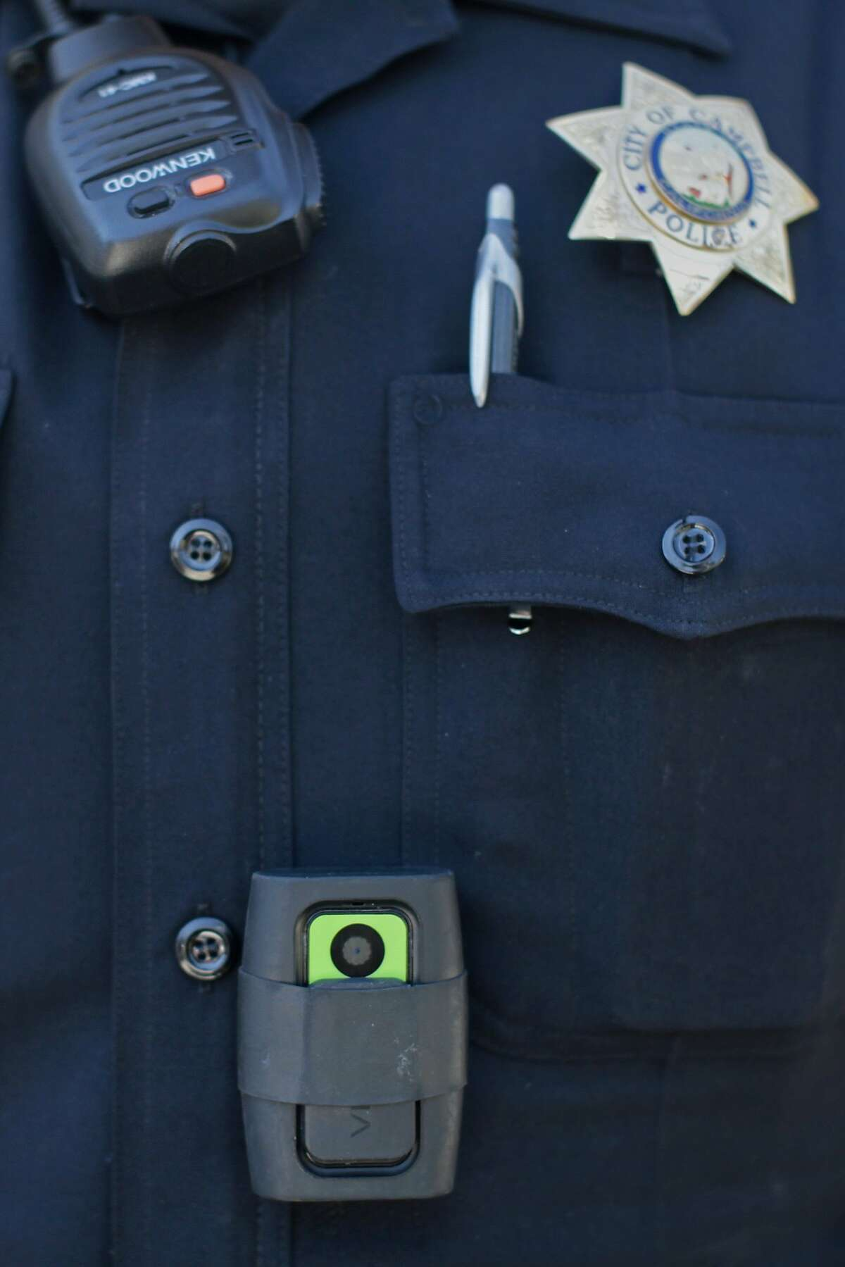Officer Matt Ryan shows off the cameras used by Campbell Police Officers while on the job on Friday, Aug. 22, 2014 in Campbell, Calif. The Campbell Police Department says that the cameras have actually helped to exonerate police officers over the years rather than harm them.